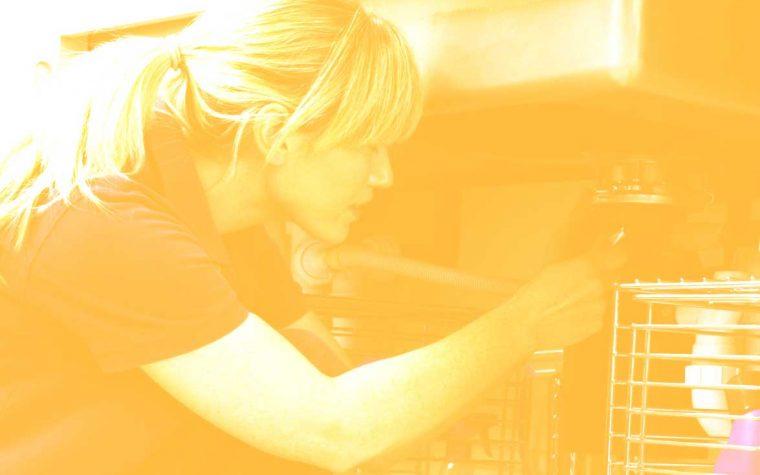 Woman repairing sink